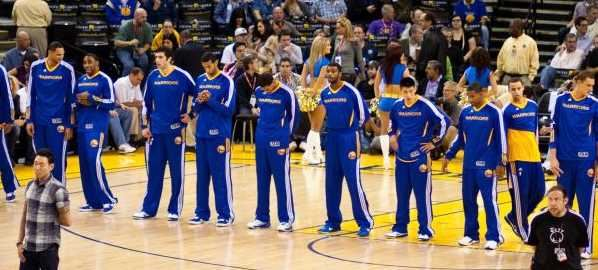 The Golden State Warriors lined up on the court.
