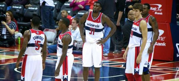 Washington Wizards players gathering before a free throw.